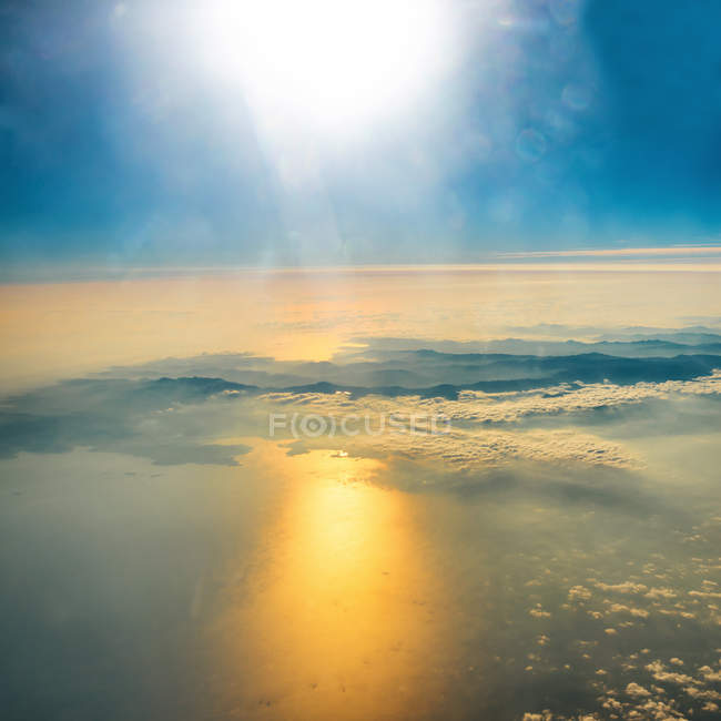 Sunset on sky with sunrays — Stock Photo