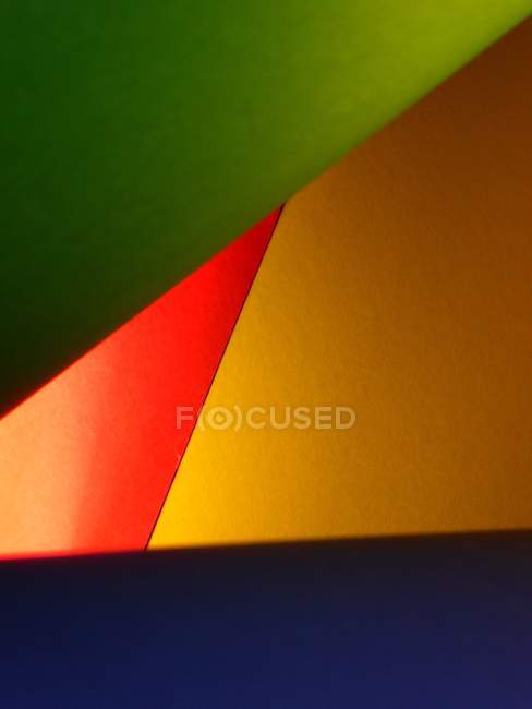 Colorful painted geometric triangles figures — Stock Photo