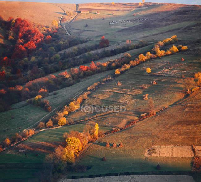 Autumn evening in mountain village — Stock Photo
