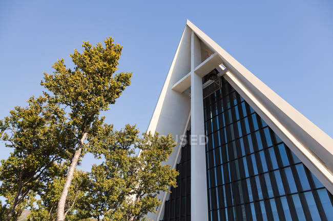 Exterior shot of building facade corner roof and tree, Norway church — Stock Photo