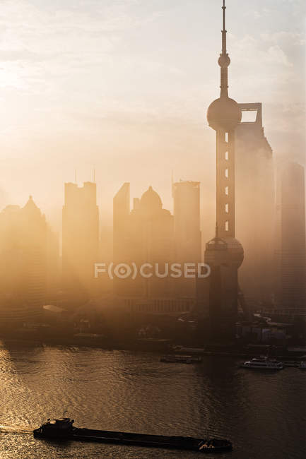 Scenic cityscape of Shanghai city with modern architecture in sunset haze, China — Stock Photo