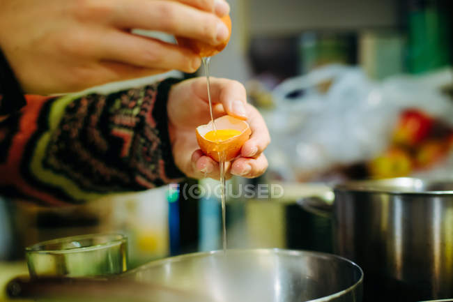 Human hands holding eggshells — Stock Photo