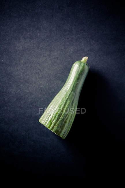 Cucumber half on black — Stock Photo