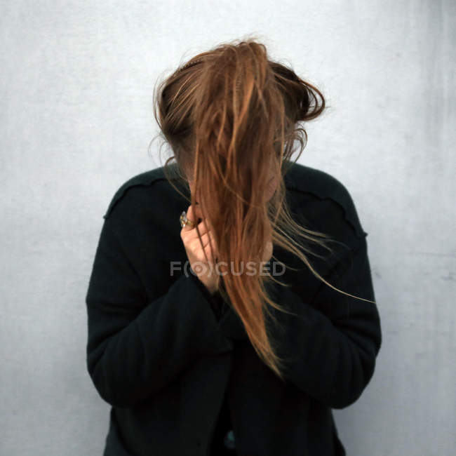 Woman Hide Face Behind Hair Front View Person Stock Photo