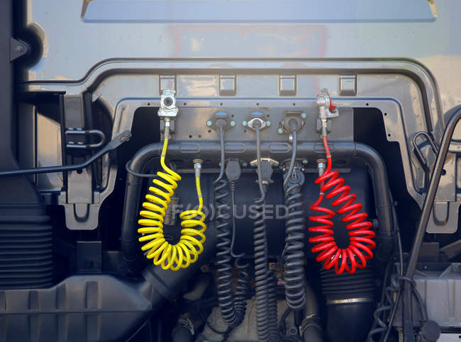 Colorful air hoses on car back — Stock Photo