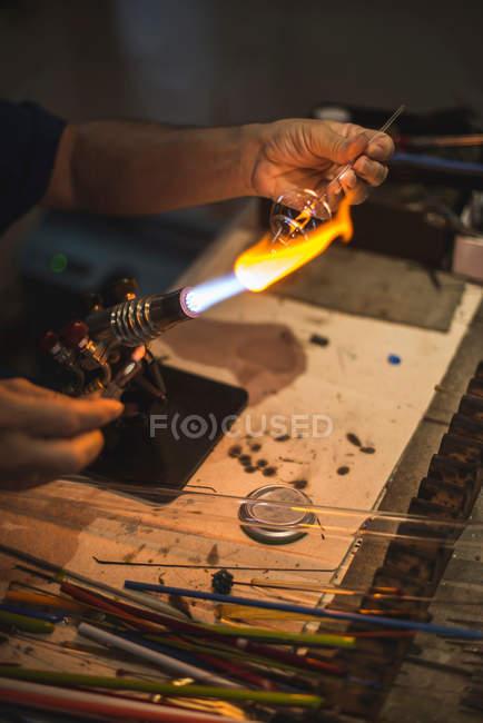 Glass blower working in workshop, handmade glassware — Stock Photo