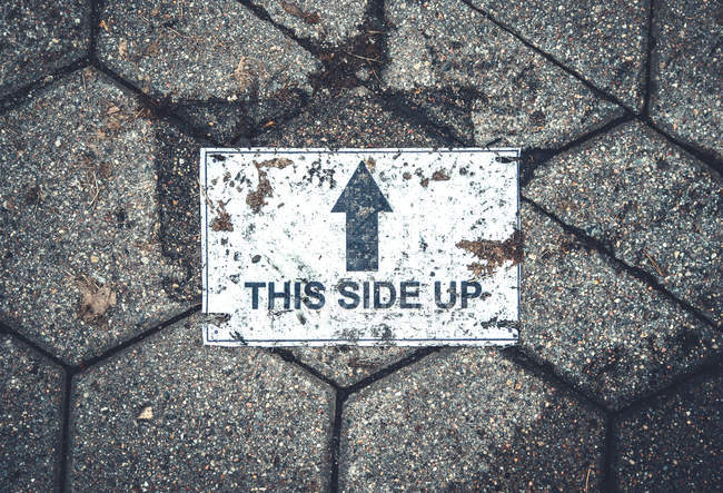 Road with arrow sign, this side up — Stock Photo