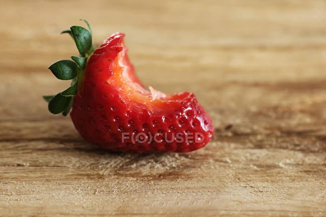 Bitten ripe strawberry — Stock Photo