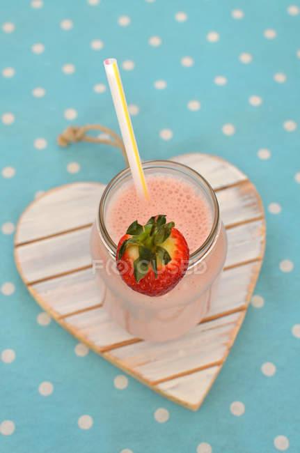 Close-up of strawberry milkshake — Stock Photo