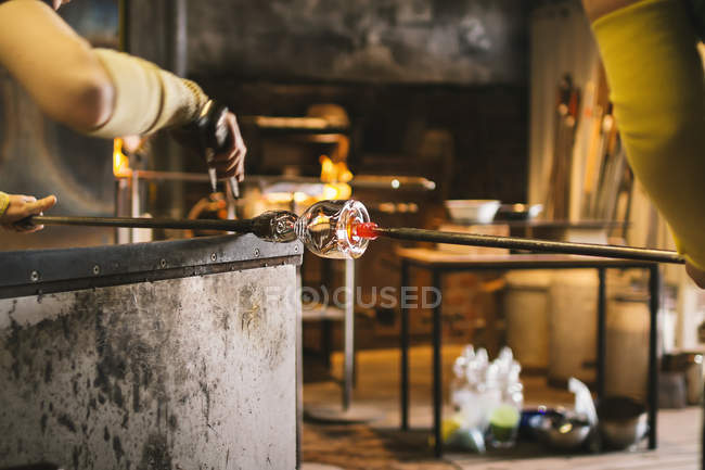 People working in workshop with glassblowing equipment and tools — Stock Photo