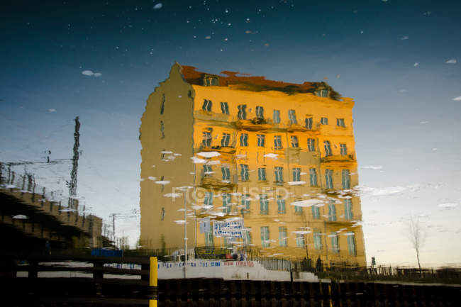 Yellow house in water reflection — Stock Photo