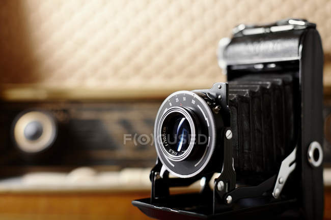 Vintage film press camera on table — Stock Photo