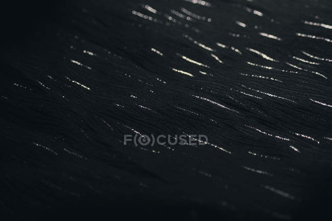 Close-up view of black glittering cloth — Stock Photo