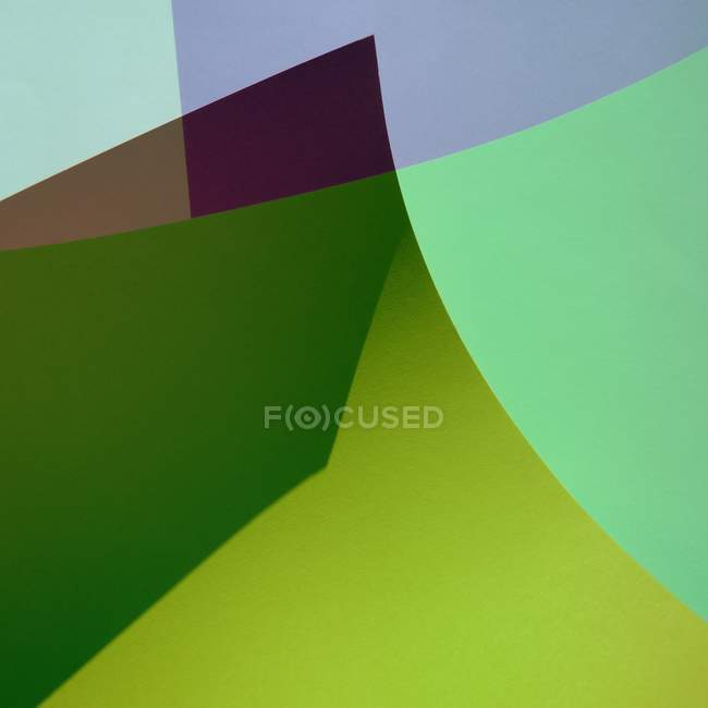 Abstract textured backdrop with colorful paper — Stock Photo