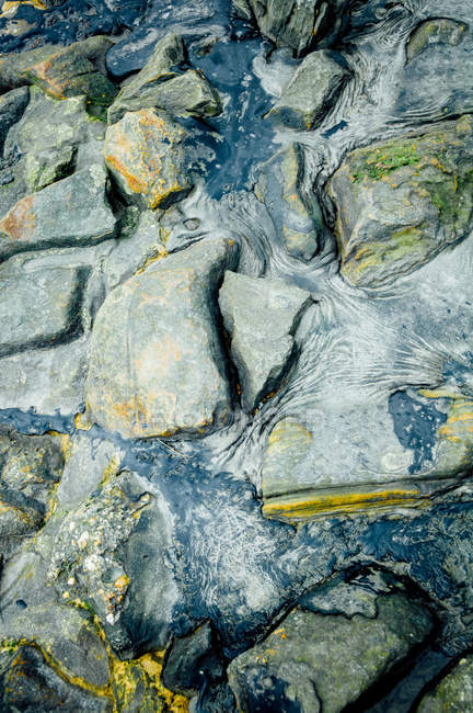 Rocks and stones in water flow — Stock Photo