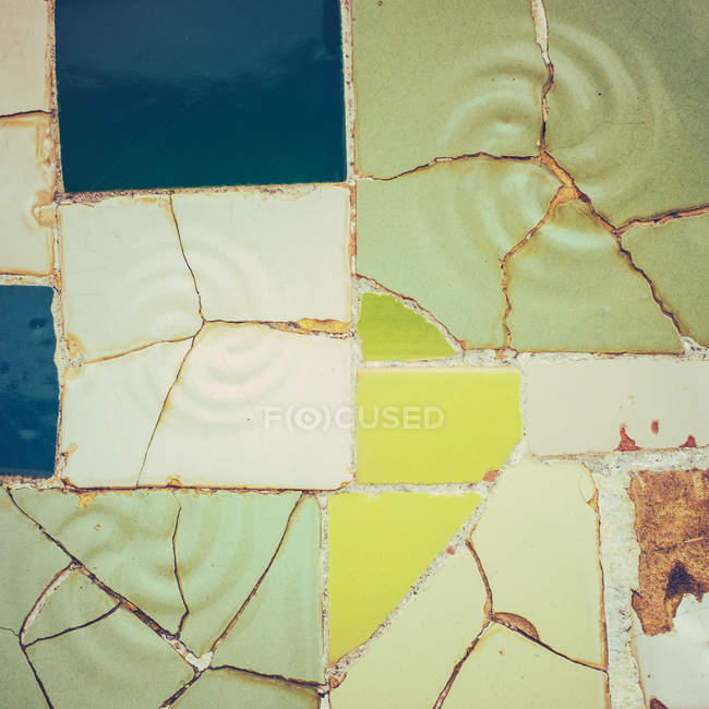 Colorful yellow lime green and blue shards as part of tile mosaic — Stock Photo