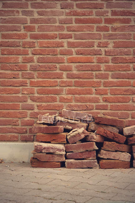 Wall texture and stake of bricks — Stock Photo