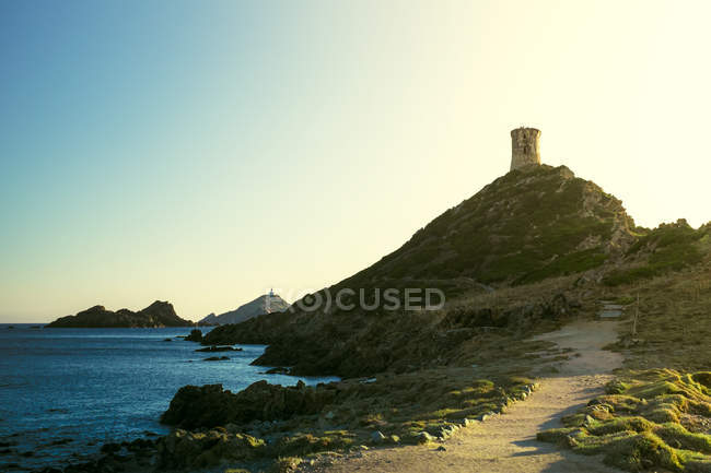 Fortress on hill and seacoast — Stock Photo