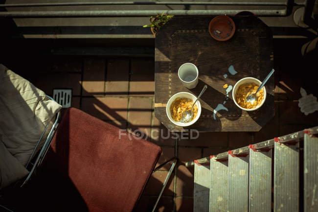 Top view of bowls with cereals served on balcony — Stock Photo