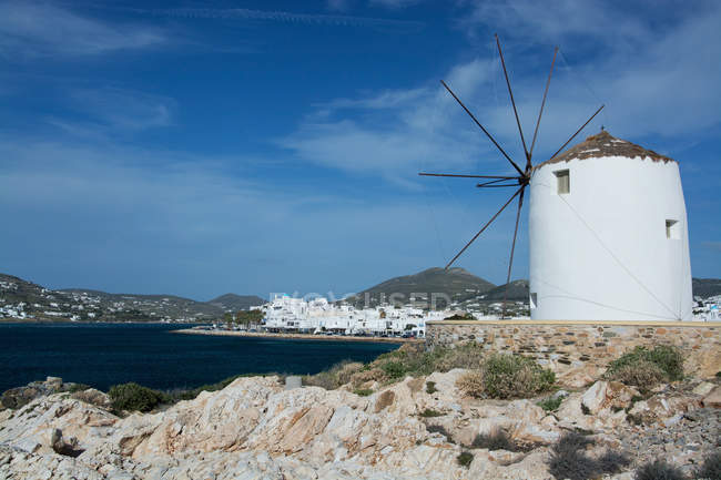 Architecture buildings at harbor, wind mill on island — Stock Photo