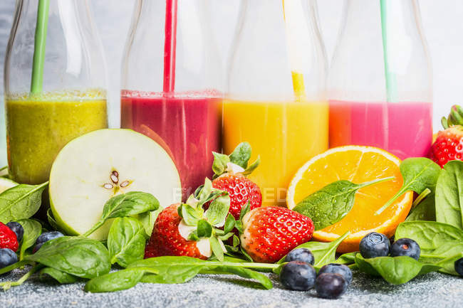 Close-up of fruits smoothies in bottles — Stock Photo