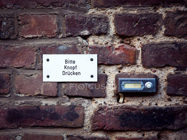 Bricks wall texture and intercom — Stock Photo