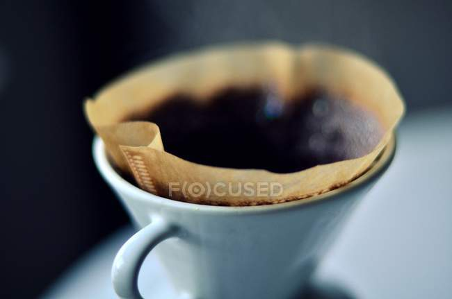Hot coffe served in mug — Stock Photo