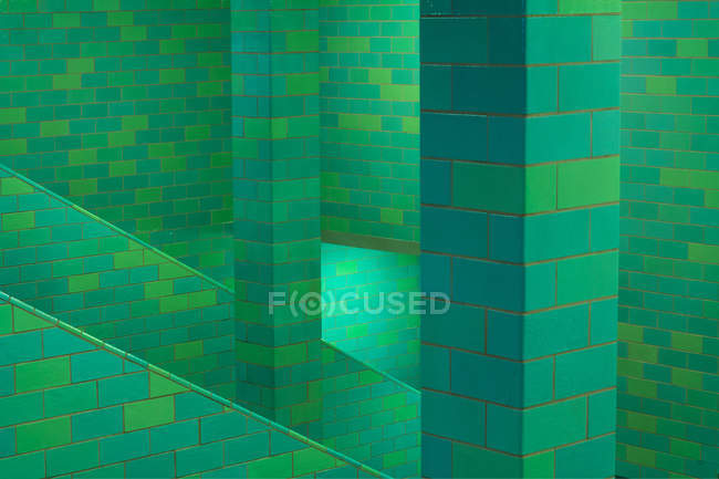 Tourquoise bricks wall of staircase — Stock Photo