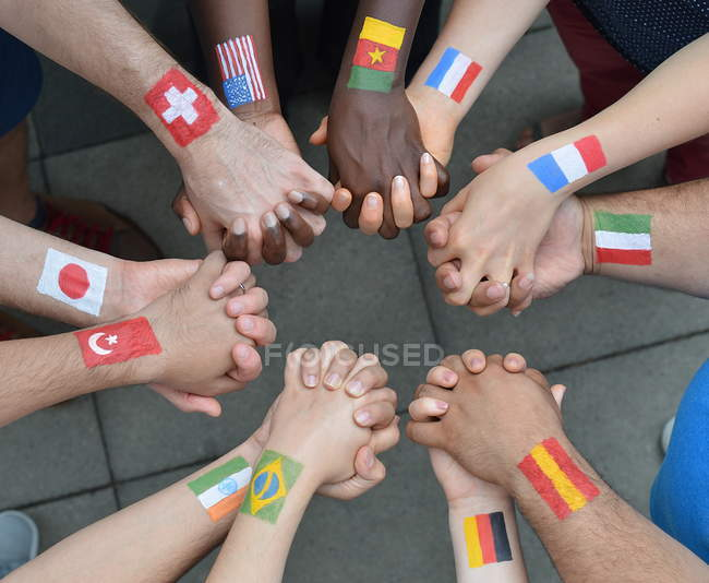 Top view of people hands with different countries flags painted — Stock Photo