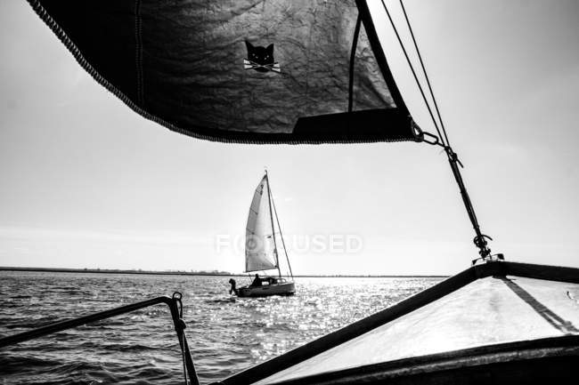 Details of yacht deck and sailboat sailing by sea in sunshine on background — Stock Photo