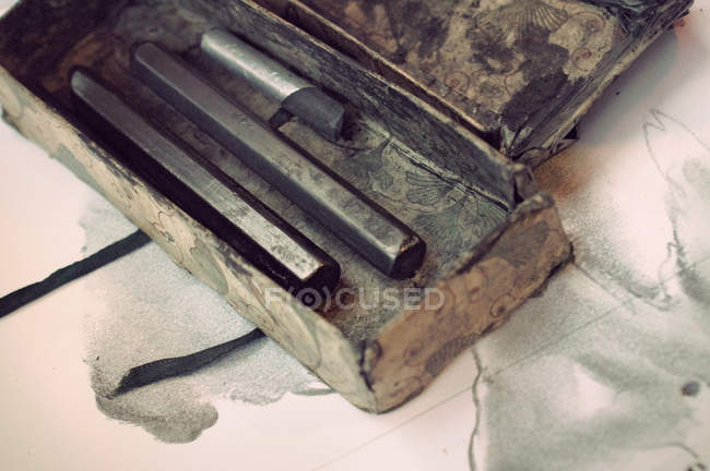 Closeup tilted view of old coat pencils in carton box — Stock Photo