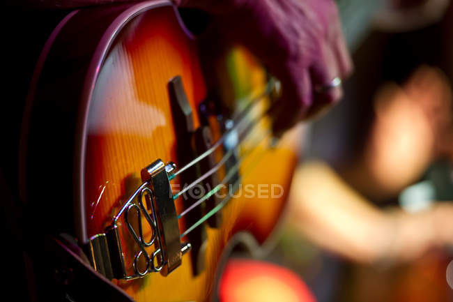 Cropped view of person playing guitar — Stock Photo