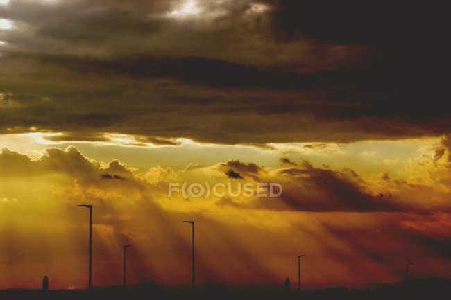 Orange sunset sky and sunbeams — Stock Photo