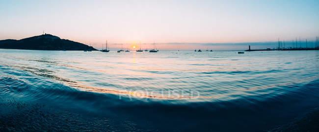 Sunrise on small bay — Stock Photo