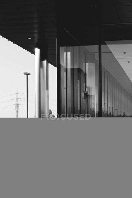 Daytime view of modern building exterior with glass walls — Stock Photo