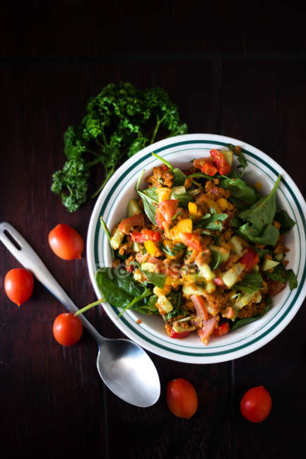 Salad with vegetables and greenery in bowl — Stock Photo