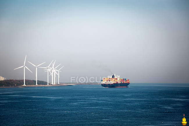 Wind mills near  the sea at daytime — Stock Photo