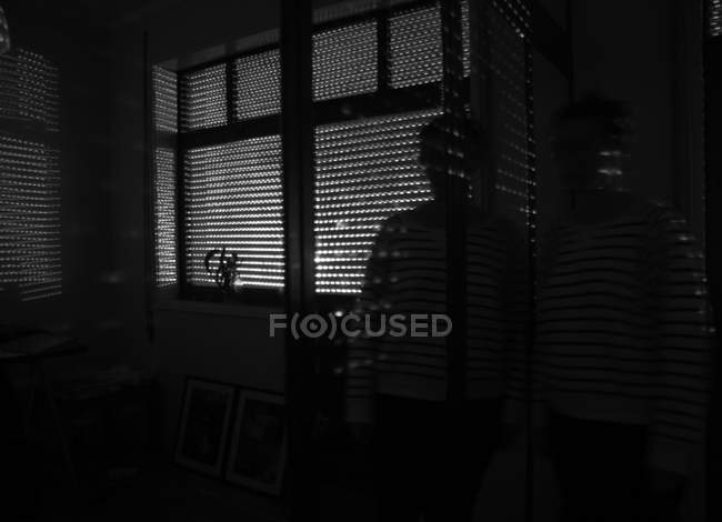Person and hunting blind, shadows on the wall — Stock Photo