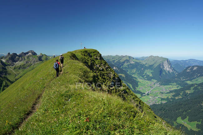 Traveler people hiking in mountains at summer — Stock Photo