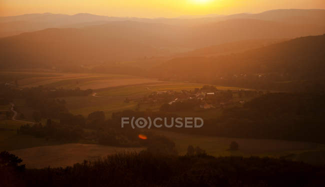 Field view at sunset time — Stock Photo