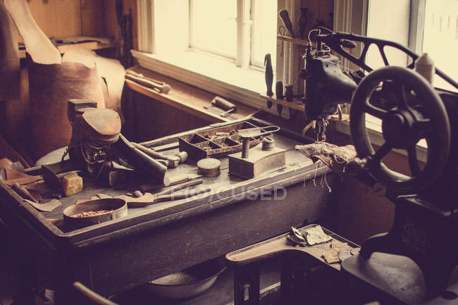 Tools on wooden table in shoemaker workshop — Stock Photo