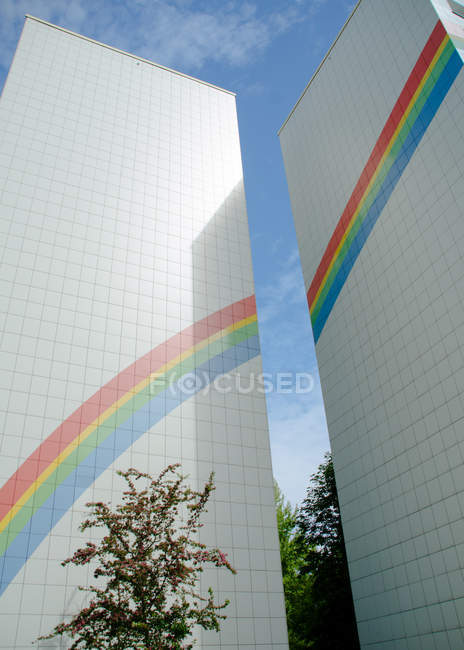 Colorful rainbow art on building facades — Stock Photo