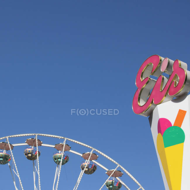 Partial view of colorful amusement park attractions — Stock Photo