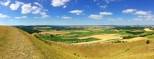 Fields and sunny sky with clouds — Stockfoto