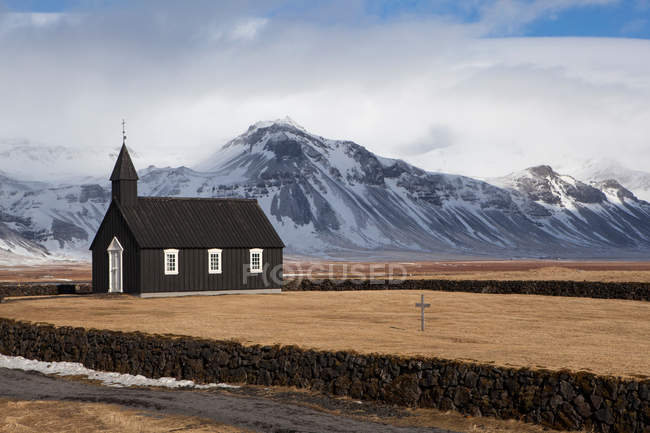 Remote place and typical church — Stock Photo