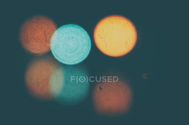 Blurred image of three lights with reflections — Stock Photo