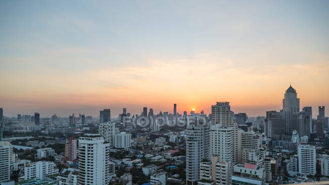 Bangkok city buildings and sunset — Stock Photo