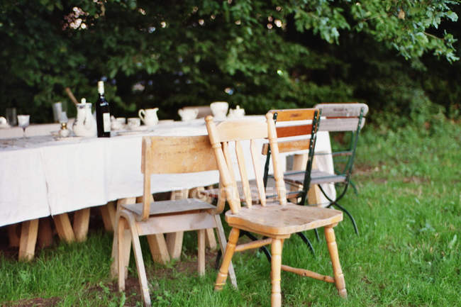 Incredible Empty Chairs By The Table After Outdoor Party On Green Lawn Interior Design Ideas Pimpapslepicentreinfo