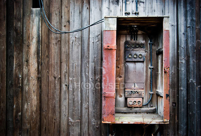 wooden planks on wall of old house and fuse-box — stock photo
