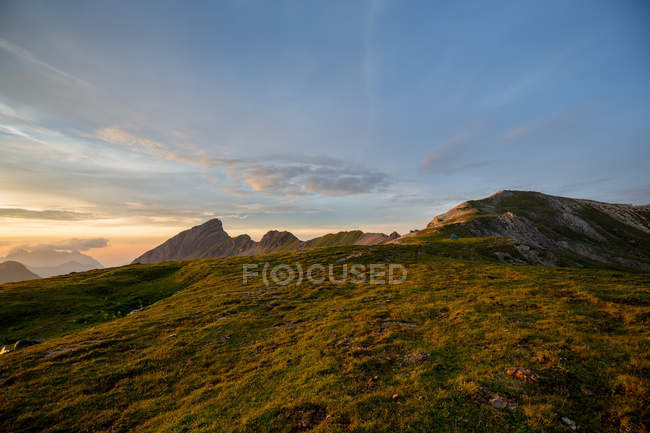 Twilight in alpine mountains meadow — Stock Photo
